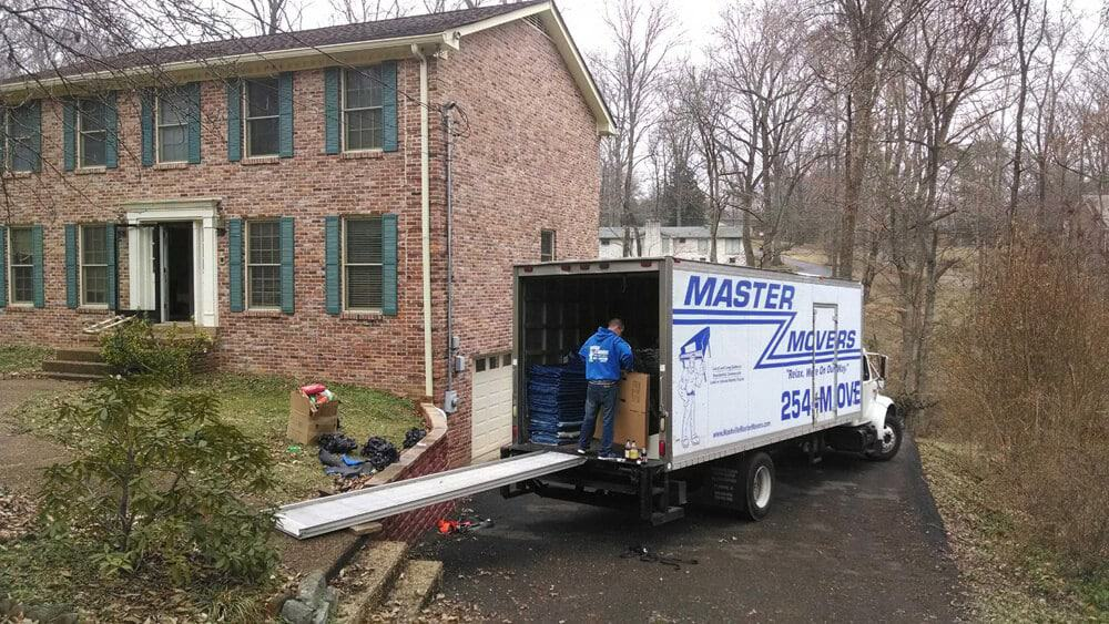 Moving truck outside of house