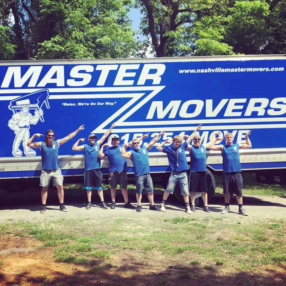 seven moving experts posing outside the Nashville Master Movers moving truck