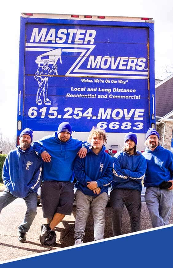 five movers who work for Master Movers in Nashville, TN standing in the back of a large moving truck